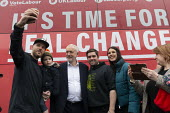 Jeremy Corbyn, selfies with supporters, Labour General Election Campaign Corby - John Harris - 2010s,2019,boy,boys,bus,bus service,buses,CAMERA,camera phone,cameras,campaign,campaigning,CAMPAIGNS,CELLULAR,child,CHILDHOOD,children,DAD,DADDIES,DADDY,DADS,DEMOCRACY,Election,elections,FAMILY,father