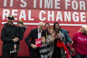Jeremy Corbyn, selfies with supporters, Labour General Election Campaign Corby - John Harris - 2010s,2019,boy,boys,bus,bus service,buses,CAMERA,camera phone,cameras,campaign,campaigning,CAMPAIGNS,CELLULAR,child,CHILDHOOD,children,DAD,DADDIES,DADDY,DADS,DEMOCRACY,Election,elections,families,fami