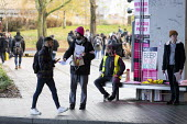 UCU strike for pensions and pay, Coventry University, leafleting students - John Harris - 2010s,2019,BAME,BAMEs,Black,Black and White,BME,bmes,Coventry,DISPUTE,disputes,diversity,EARNINGS,ethnic,ethnicity,Income,INCOMES,Industrial dispute,LEAFLET,LEAFLETING,LEAFLETS,leafletting,Low Pay,Low