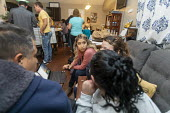 Aurora, Colorado, USA Volunteers at Casa de Paz helping immigrants released from an immigrant detention center. Providing meals, a bed, clothing and toiletries and help in arranging transport. Volunte... - Jim West - 08-11-2019