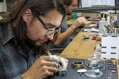 Colorado, USA. Workers making watches by hand, Vortic Watch Company. The company salvages and restores antique pocket watches, making them into expensive wrist watches - Jim West - 2010s,2019,America,antique,Colorado,company,craft,craftsman,EBF,Economic,Economy,employee,employees,Employment,Fort Collins,job,jobs,LBR,machine,machinery,machines,make,maker,makers,making,mechanism,p