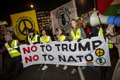 No to Trump, No to NATO Protest London - Jess Hurd - peace movement,2010s,2019,activist,activists,against,banner,banners,Campaign for nuclear disarmament,CAMPAIGNING,CAMPAIGNS,CND,CND Symbol,DEMONSTRATING,demonstration,London,NATO,No to Trump - No to NA