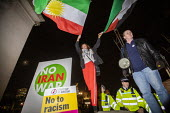 No Iran War, No to Trump, No to NATO Protest London - Jess Hurd - 2010s,2019,activist,activists,against,CAMPAIGNING,CAMPAIGNS,DEMONSTRATING,demonstration,FEMALE,flag,flags,Iran,iranian,Iranians,London,NATO,No to Trump - No to NATO,people,person,persons,placard,placa