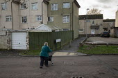 Pedestrians, Hazel Leys, Corby, Northamptonshire - John Harris - 2010s,2019,adult,adults,age,ageing population,Council Housing,Council Housing,disabilities,disability,disable,disabled,disablement,elderly,excluded,exclusion,FEMALE,flat,flats,HARDSHIP,house,houses,Ho