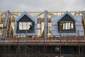 New houses under construction, Ashchurch, Gloucestershire. Lindin Homes - John Harris - 2010s,2019,builder,builders,building,building site,BUILDINGS,carpenter,carpenters,carpentry,construction,Construction Industry,Construction Workers,development,EBF,Economic,Economy,employee,employees,