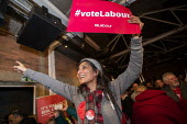 Labour supporters, General election rally, Hoxton Docks, Hackney, East London - Jess Hurd - 2010s,2019,audience,AUDIENCES,BAME,BAMEs,Black,Black and White,BME,bmes,campaign,campaigning,CAMPAIGNS,DEMOCRACY,diversity,DOCK,Docks,East London,election,elections,ethnic,ethnicity,eve of poll,FEMALE