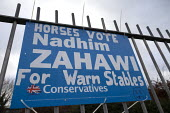 Horses Vote Nadhim Zahawi For Warm Stables, grafftti on a Conservatives general election poster referring to MPs expenses scandle when Millionaire Conservative MP Nadhim Zahawi claimed taxpayer's mone... - John Harris - Conservative,Conservative Party,conservatives,DEMOCRACY,Domesticated Ungulates,election,elections,ELECTRICAL,electricity,equestrian,equine,expenses scandle,General Election,Graffiti,home,horse,Horses,