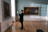 Visitor taking a picture on his phone, Compton Verney Art Gallery Masterpieces from the Golden Age of Neapolitan art from 1600 to 1800, Vesuvius Erupting at Night by Pierre-Jacques Volaire - John Harris - 15-12-2019