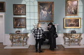 Visitors discussing The Incredulity of Saint Thomas by Mattia Preti, Compton Verney Art Gallery at Masterpieces from the Golden Age of Neapolitan art from 1600 to 1800 - John Harris - 2010s,2019,ACE,adult,adults,AFFLUENCE,AFFLUENT,age,ageing population,art,Art Gallery,arts,artwork,artworks,Bourgeoisie,communicating,communication,conversation,conversations,culture,dialogue,discourse