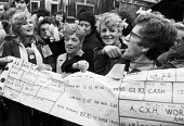 Health workers with an giant pay slip lobby Parliament for better pay, London 1982 - NLA - 15-03-1982