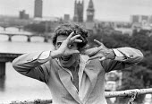 Snapping the snappers. Marcel Marceau, 1984, French mine artist and actor, pointing his imaginary camera at photographers in London. - NLA - 1980s,1984,ACE,Arts,Bip the Clown,camera,cameras,comedian,comedians,comedy,Culture,ENTERTAINER,ENTERTAINERS,French,FUNNY,HUMOROUS,HUMOUR,joking,Marcel Marceau,mine,mine artists,MINES,photographers