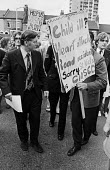 David Ennals MP passing angry protestors opposed to closure, St Nicholas Hospital, Greenwich, South London 1977 - NLA - 26-09-1977