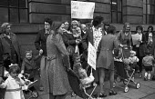 Mothers and children protest at the lack of amenities on a council housing estate, Hull, Yorkshire, 1974. The banner reads: Our children ask What is a garden? - NLA - 22-02-1974
