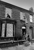 Workers bricking up terraced houses prior to demolition, Anfield, Liverpool 1978 - NLA - 1970s,1978,Anfield,brick,Brick Wall,bricked up,bricklayer,bricklayers,bricklaying,bricks,builder,builders,building,Building Worker,buildings,cities,City,Construction Industry,demolish,DEMOLISHED,demol