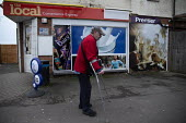 Disabled man on crutches, local corner shop, Stratford upon Avon, Warwickshire - John Harris - 2020,2020s,advertisement,advertisements,advertising,age,ageing population,bought,buying,consumer,consumers,Corner Shop,crutches,customer,customers,disabilities,disability,disable,disabled,disablement,