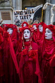The Invisible Circus, Extinction Rebellion activists dressed in red robes and with white makeup Demand Action on Australian Fires, Australian High Commission, London - Jess Hurd - 10-01-2020