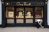 Woman sweeping up, George Pragnell, prestige jewellers, Stratford upon Avon, Warwickshire - John Harris - 09-01-2020