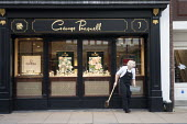 Woman sweeping up, George Pragnell, prestige jewellers, Stratford upon Avon, Warwickshire - John Harris - 2020,2020s,brush,brushing,clean,cleaner,cleaners,cleaning,cleansing,dustpan and brush,EBF,Economic,Economy,employee,employees,Employment,FEMALE,jewellery,jewelry,job,jobs,LBR,Low Pay,luxury,older,outl