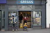 Greggs selling vegetarian sausage rolls, Stratford upon Avon, Warwickshire - John Harris - 2020,2020s,adult,adults,bakery,BAME,BAMEs,Black,BME,bmes,bought,boy,boys,buying,child,CHILDHOOD,children,consumer,consumers,customer,customers,diversity,eat,eating,EBF,Economic,Economy,ethnic,ethnicit