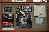 Be Extra Ordinary recruitment poster for retained firefighters, Stratford upon Avon Fire Station notice board, Warwickshire. Smoke Alarms Save Lives - John Harris - 2020,2020s,adult,adults,advertisement,advertisements,advertising,DIA,Emergency Services,employee,employees,Employment,Fire,Fire and Rescue Service,fire brigade,Firefighter,firefighters,Firefighting,fi