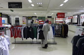 Debenhams store closing down sale, last day, The Fort Shopping Centre, Birmingham - John Harris - 2020,2020s,apparel,BAME,BAMEs,Birmingham,Black,BME,bmes,bought,browsing,buy,buyer,buyers,buying,choice,choosing,clearance,CLEARENCE,clearing,close,closed,closing,closure,closures,clothes,clothing,cons