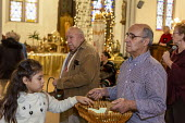 Detroit, Michigan USA, Holy Hour, supporting refugees fleeing violence, Most Holy Trinity Catholic Church. Parishoners commitments to prayer, fasting and action in support of migrants were collected i... - Jim West - 11-01-2020