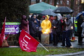 Northern Ireland Health Workers strike over safe staffing levels and pay parity, Downshire Hospital, Downpatrick. Attempting to Keep Warm in the rain - Conor Kinahan - 2010s,2019,assistant,assistants,brazier,BRAZIERS,DISPUTE,disputes,Downpatrick,Downshire Hospital,EARNINGS,Equality,Fair Pay,Fire,fires,Health,Health Worker,health workers,healthcare,Hospital,HOSPITALS