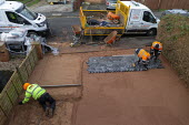 Workers laying a new block driveway, Stratford upon Avon, Warwickshire - John Harris - 2020,2020s,block,block paver,blocks,by hand,Construction Industry,Drive Co Driveways Ltd,drives,driveway,EBF,Economic,Economy,employee,employees,Employment,groundwork,job,jobs,lay,laying,LBR,musculosk