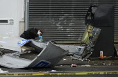 Gloucester Road, Bristol, Forensic scientist examinng a Cashpoint machine destroyed in an explosion - Sam Morgan Moore - 30-01-2020