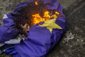Burning the EU Flag, Brexit Day, Westminster, London. - Jess Hurd - 2020,2020s,activist,activists,against,Brexit,Brexit Day,burn,burning,BURNS,CAMPAIGNING,CAMPAIGNS,DEMONSTRATING,demonstration,EU,European Union,flag,flags,Independence,leave,London,nationalism,national