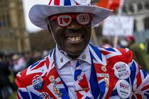 Joseph Afrane, Brexit Day, Westminster, London. - Jess Hurd - 2020,2020s,activist,activists,against,BAME,BAMEs,Black,BME,bmes,Brexit,Brexit Day,CAMPAIGNING,CAMPAIGNS,DEMONSTRATING,demonstration,diversity,ethnic,ethnicity,EU,European Union,flag,flags,Independence