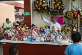 Oaxaca de Juarez, Mexico Fr. Hector Zavala Balboa celebrating mass, Sanchez Pascuas neighborhood market, Dia de la Candelaria, celebrating 40 days after the birth of Jesus. Families dress up dolls of... - Jim West - 2020,2020s,BABIES,Baby,baby Jesus,Belief,birth,bless,blessing,Candelaria,Candlemas,Catholic,catholicism,Catholics,CELEBRATE,celebrating,celebration,CELEBRATIONS,ceremonial,ceremonies,ceremony,christia