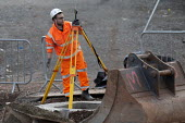 Surveyor at work, Construction site, Coventry & Warwickshire Gateway - John Harris - 2020,2020s,BUILDING,building site,BUILDINGS,Construction,Construction Industry,EBF,Economic,Economy,employee,employees,Employment,horizontal and vertical angles,job,jobs,LBR,MEASURE,MEASUREMENT,measur