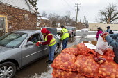 Detroit, USA Volunteers distributing food to the poor, MorningSide Community Organization. Groceries were donated by Gleaners Community Food Bank - Jim West - 2020,2020s,African American,African Americans,America,assisting,BAME,BAMEs,Bank,BANKS,black,BME,bmes,charitable,charity,cities,City,communities,Community,community organization,community service,Detro