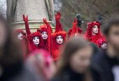 The Invisible Circus, Extinction Rebellion activists dressed in red robes and with white makeup, Bristol Youth Strike 4 Climate protest - Paul Box - 2020,2020s,ACE,ACTIVIST,activists,against,Arts,campaigner,campaigners,CAMPAIGNING,CAMPAIGNS,Climate Change,crisis,Culture,DEMONSTRATING,Demonstration,DEMONSTRATIONS,environment,environmental,Extinctio