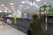 Toilet rolls disappearing off the shelves, Coronavirus panic buying as customers stockpile, Morrisons Supermarket, Stratford upon Avon, Warwickshire - John Harris - 2020,2020s,age,ageing population,bought,buy,buyer,buyers,buying,commodities,commodity,consumer,consumers,contagion,contagious,Coronavirus,Covid 19,COVID-19,crisis,customer,customers,demand,disease,DIS