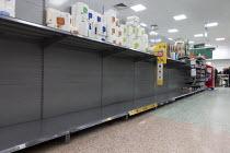 Toilet rolls disappearing off the shelves, Coronavirus panic buying as customers stockpile, Morrisons Supermarket, Stratford upon Avon, Warwickshire - John Harris - 2020,2020s,bought,buy,buyer,buyers,buying,commodities,commodity,consumer,consumers,contagion,contagious,Coronavirus,Covid 19,COVID-19,crisis,customer,customers,demand,disease,DISEASES,EBF,Economic,Eco