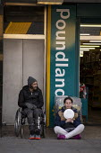 Homeless begging outside Poundland, Dudley, West Midlands - John Harris - 2020,2020s,beg,beggar,beggars,BEGGER,begging,begs,bound,disabilities,disability,disable,disabled,disablement,Dudley,excluded,exclusion,FEMALE,HARDSHIP,homeless,homelessness,impoverished,impoverishment