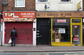 Worker opening Pizza shop and closed cafe, Dudley, West Midlands - John Harris - 08-03-2020