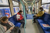 Commuters with face masks, Docklands Light Railway to protect against Coronavirus , East London. - Jess Hurd - 18-03-2020