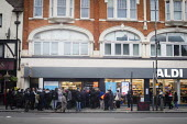 Queuing for food, Aldi Supermarket, Kilburn, London - Connor Matheson - 2020,2020s,Aldi,bought,busy,buy,buyer,buyers,buying,cities,City,commodities,commodity,consumer,consumers,contagious,coronavirus,Covid 19,crisis,crowd,crowded,customer,customers,demand,disease,DISEASES