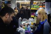 Queuing for food, Aldi Supermarket, Kilburn, London - Connor Matheson - 2020,2020s,Aldi,BAME,BAMEs,Black,BME,bmes,bought,busy,buy,buyer,buyers,buying,cities,City,commodities,commodity,consumer,consumers,contagious,coronavirus,Covid 19,crisis,crowd,crowded,customer,custome