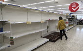Empty shelves due to panic buying, Tesco, Bristol. - Sam Morgan Moore - 2020,2020s,bought,buy,buyer,buyers,buying,commodities,commodity,communicating,communication,consumer,consumers,contagion,contagious,Coronavirus,Covid 19,COVID-19,crisis,customer,customers,demand,disea