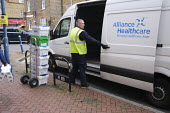 Alliance Healthcare delivery driver delivering pharmaceutical, surgical, medical, and healthcare products, London - Duncan Phillips - 2020,2020s,cart,carts,cities,City,coronavirus,covid-19,crisis,deliveries,delivering,delivery,disease,DISEASES,driver,drivers,DRIVING,drug,drugs,EBF,Economic,Economy,epidemic,Healthcare,logistics indus