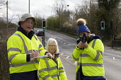 Community Speedwatch group measuring vehicle speed in a 30 mph speed limit. Trained volunteers from the local community monitoring the speeds of vehicles with approved, hand held speed measurement dev... - John Harris - 11-03-2020