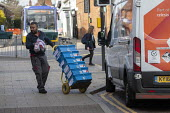 AAH delivery driver delivering pharmaceutical, surgical, medical, and healthcare products, London - John Harris - 2020,2020s,cart,carts,coronavirus,covid-19,crisis,deliveries,delivering,delivery,disease,DISEASES,driver,drivers,DRIVING,drug,drugs,EBF,Economic,Economy,epidemic,logistics industry,Logistics Services,