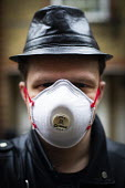 Young man wearing a face mask, Kilburn, London - Connor Matheson - 2020,2020s,apparel,clothing,coronavirus,covid-19,crisis,disease,DISEASES,epidemic,face,face mask,face masks,FACES,hat,hats,hazard,hazardous,hazards,HEA,Health,Health and Safety,hygiene,Kilburn,London,