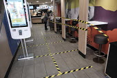 McDonald���s seating taped off seating areas to help customers to keep social distance, Richmond, London - Duncan Phillips - 2020,2020s,bought,buying,catering,cities,City,close,closed,closing,closure,closures,consumer,consumers,coronavirus,covid-19,crisis,customer,customers,disease,DISEASES,epidemic,fast food,fast food,fast