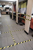 McDonald���s seating taped off seating areas to help customers to keep social distance, Richmond, London - Duncan Phillips - 2020,2020s,catering,cities,City,close,closed,closing,closure,closures,coronavirus,covid-19,crisis,CUSTOMER,customers,disease,DISEASES,epidemic,fast food,fast food,fastfood,HEA,Health,help,HELPING,HELP