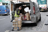 Driver making a delivery. Delivery drivers are amongst those workers deemed essential to the coronavirus response, Richmond, London - Duncan Phillips - 20-03-2020